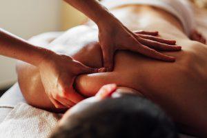 Close-up of masseur's hands massaging a client's back